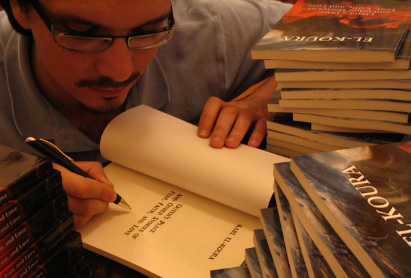 Author signing copies of his short story anthology